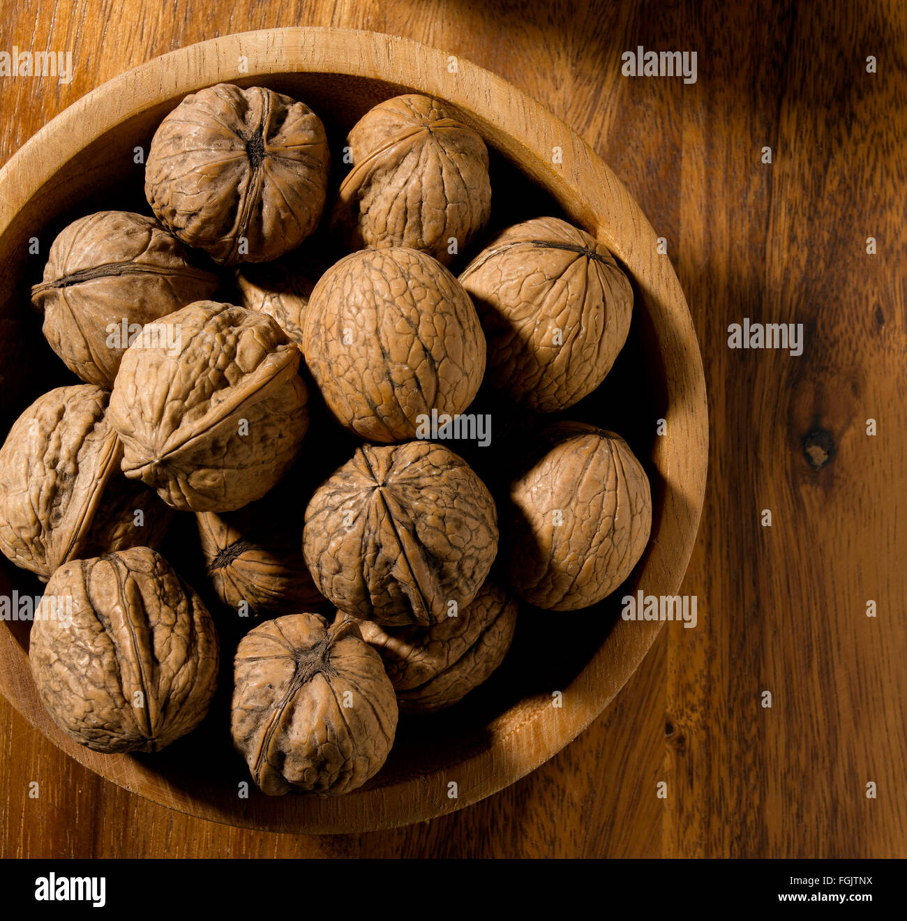 Walnut isolated in bowl on tabletop - Stock Image
