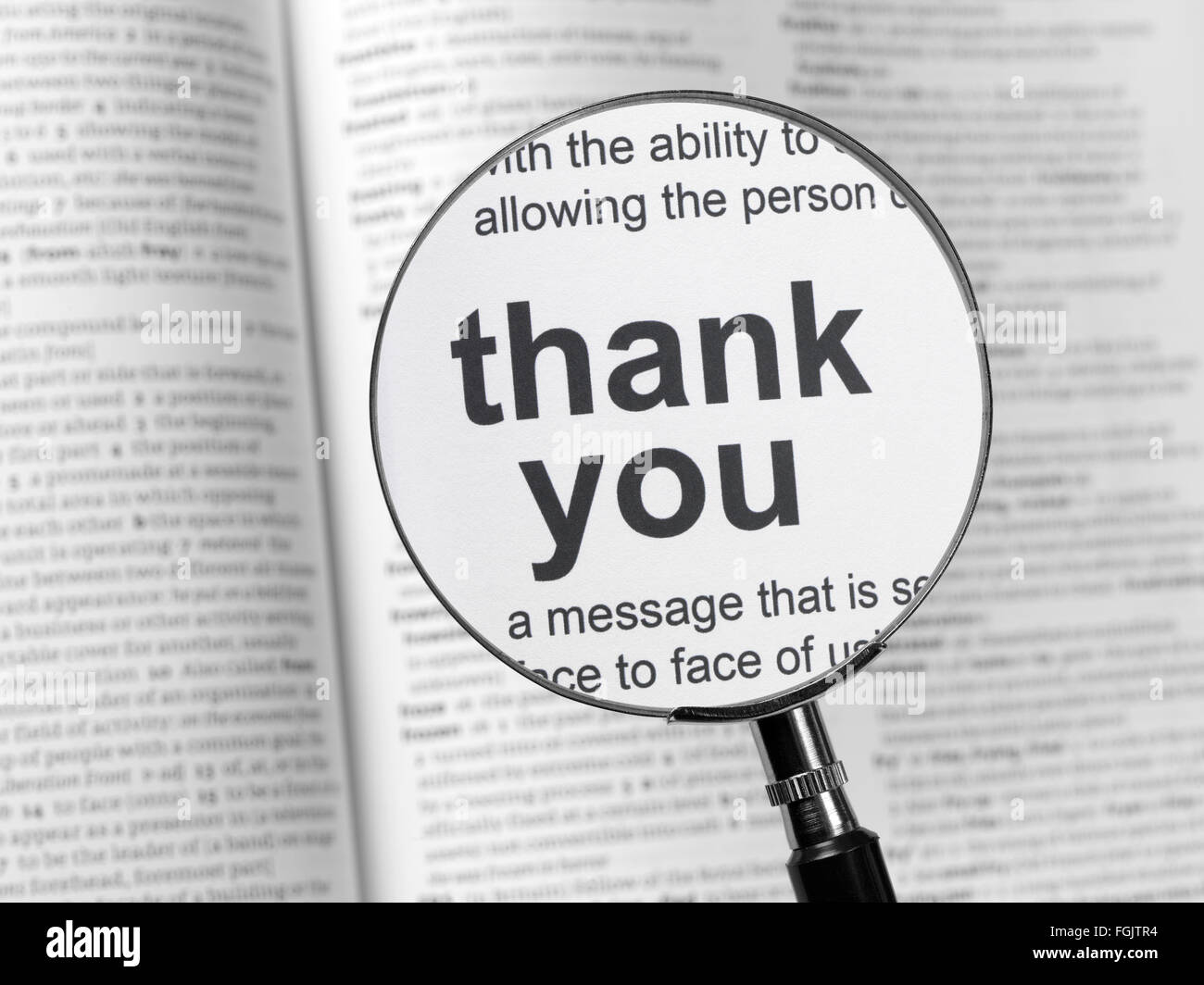 Dictionary highlighting Thank You - Stock Image