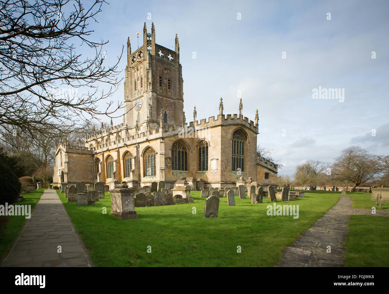 St Mary's Church in the village of Fairford, Gloucestershire - Stock Image