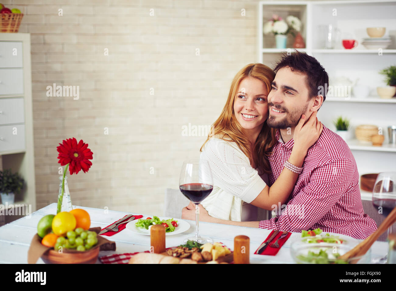 Happy couple having romantic dinner in the kitchen Stock Photo ...