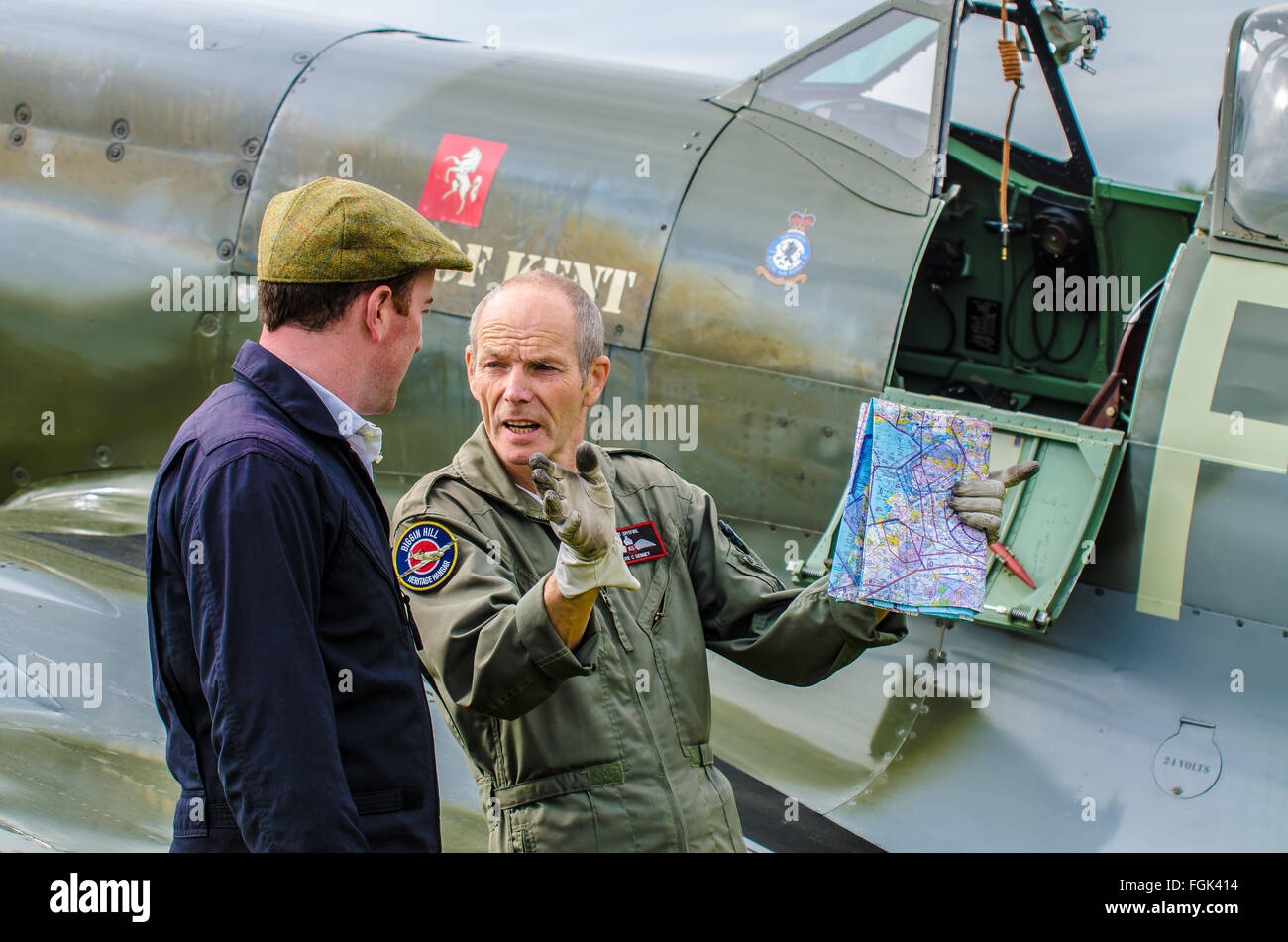 Pilots Richard Grace and Clive Denney plan their maneuvers for an air display at the Goodwood Revival 2015. Spitfire. - Stock Image