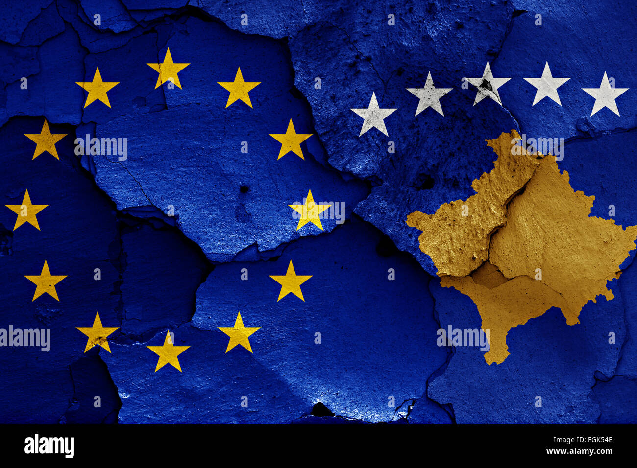 flags of EU and Kosovo painted on cracked wall - Stock Image