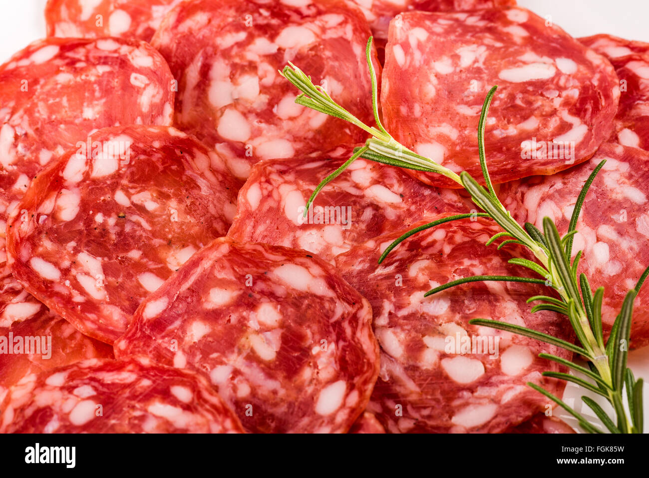Italian salami with pepper, milan, bratwurst, finely chopped, rosemary, meat, pork, spicy, aroma, spice, tasty, - Stock Image