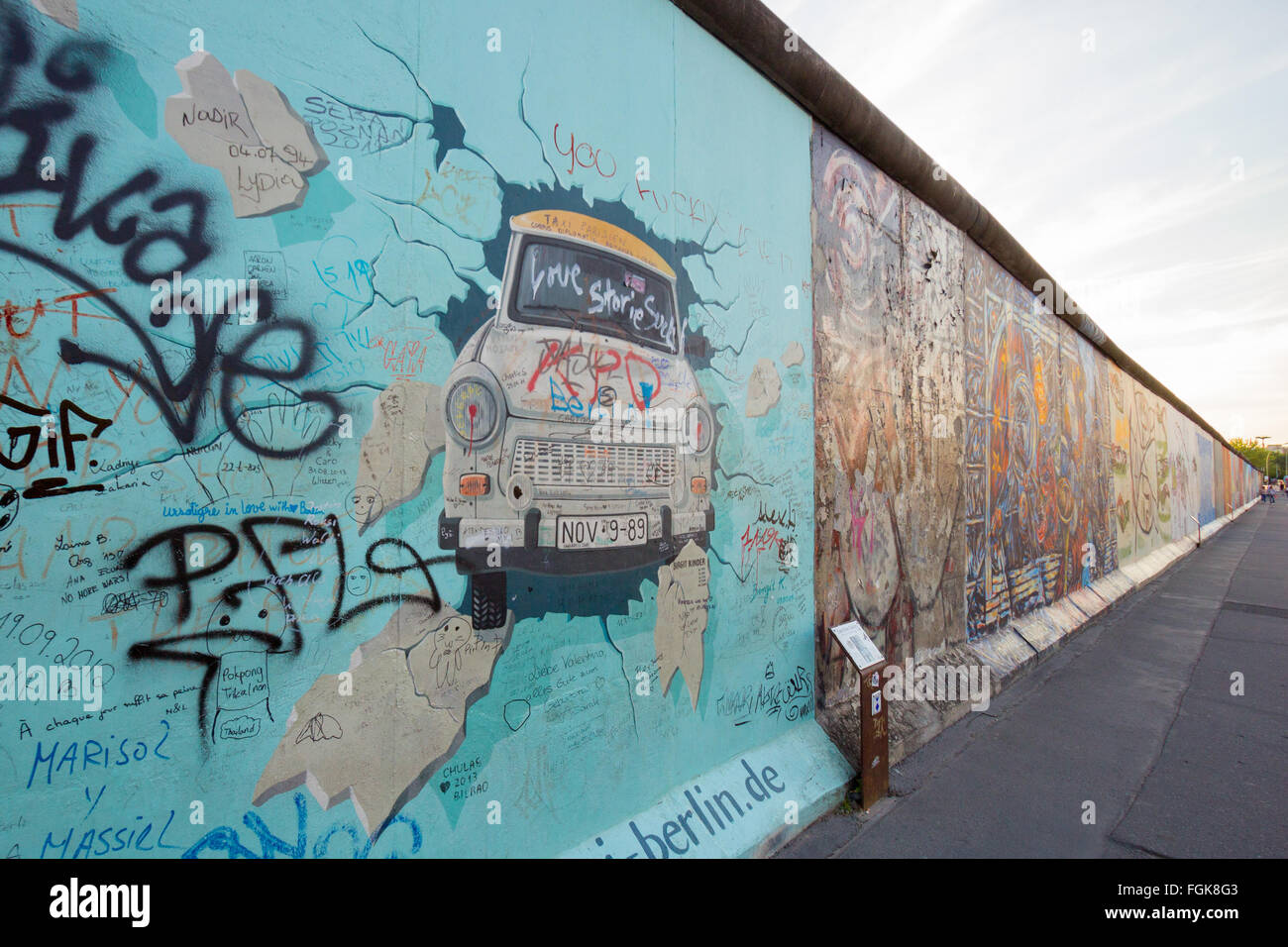 Fragment of the East Side Gallery. It's a 1.3 km long part of original Berlin Wall which collapsed in 198 - Stock Image