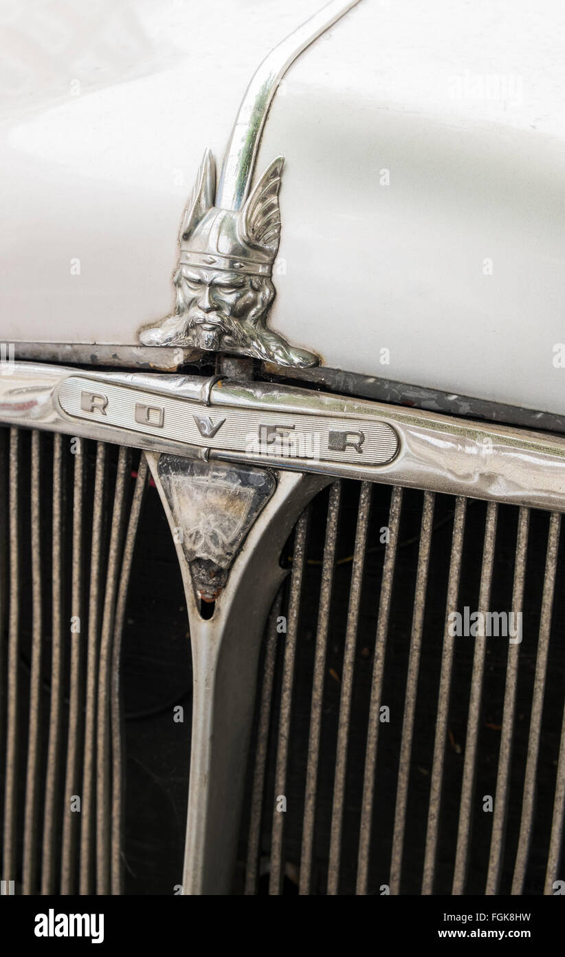 hood of an old rover car decorated with  a male warrior figure - Stock Image