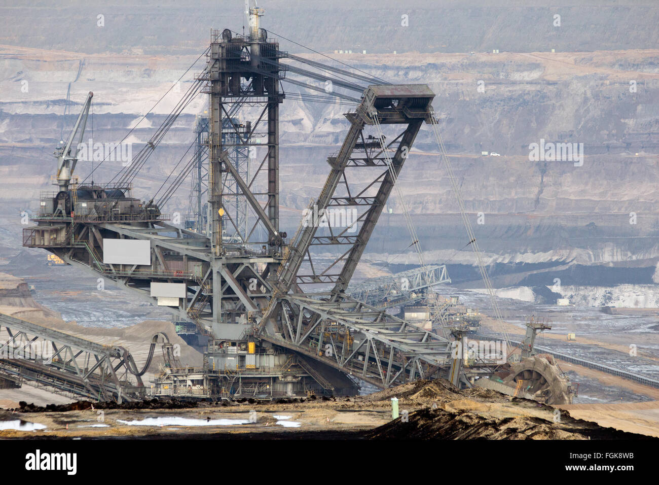 Digger machine in a brown coal open pit mine - Stock Image