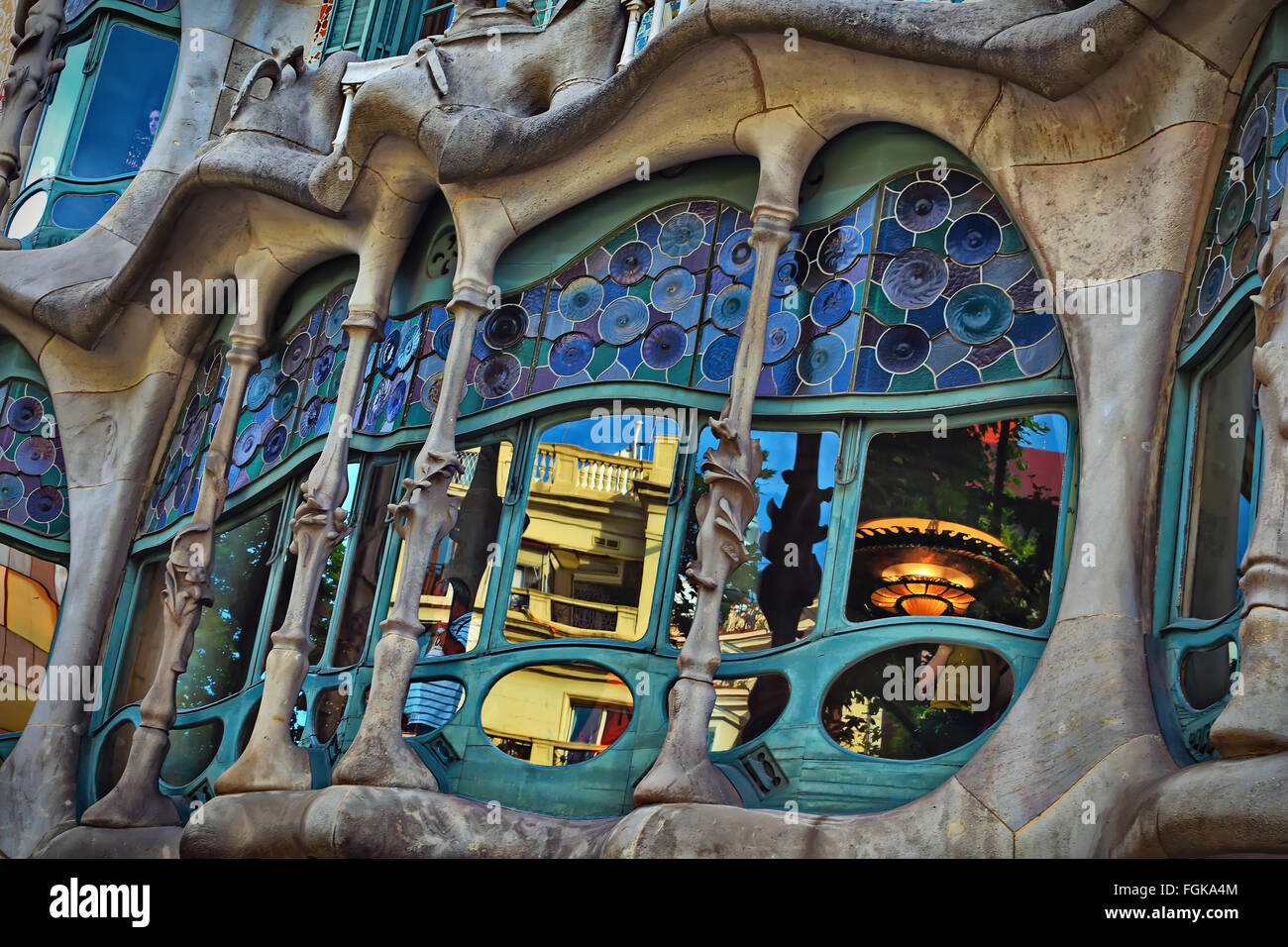 Gaudi project.The facade of the famous building Casa Battlo designed by Antonio Gaudi in Barcelona - Stock Image