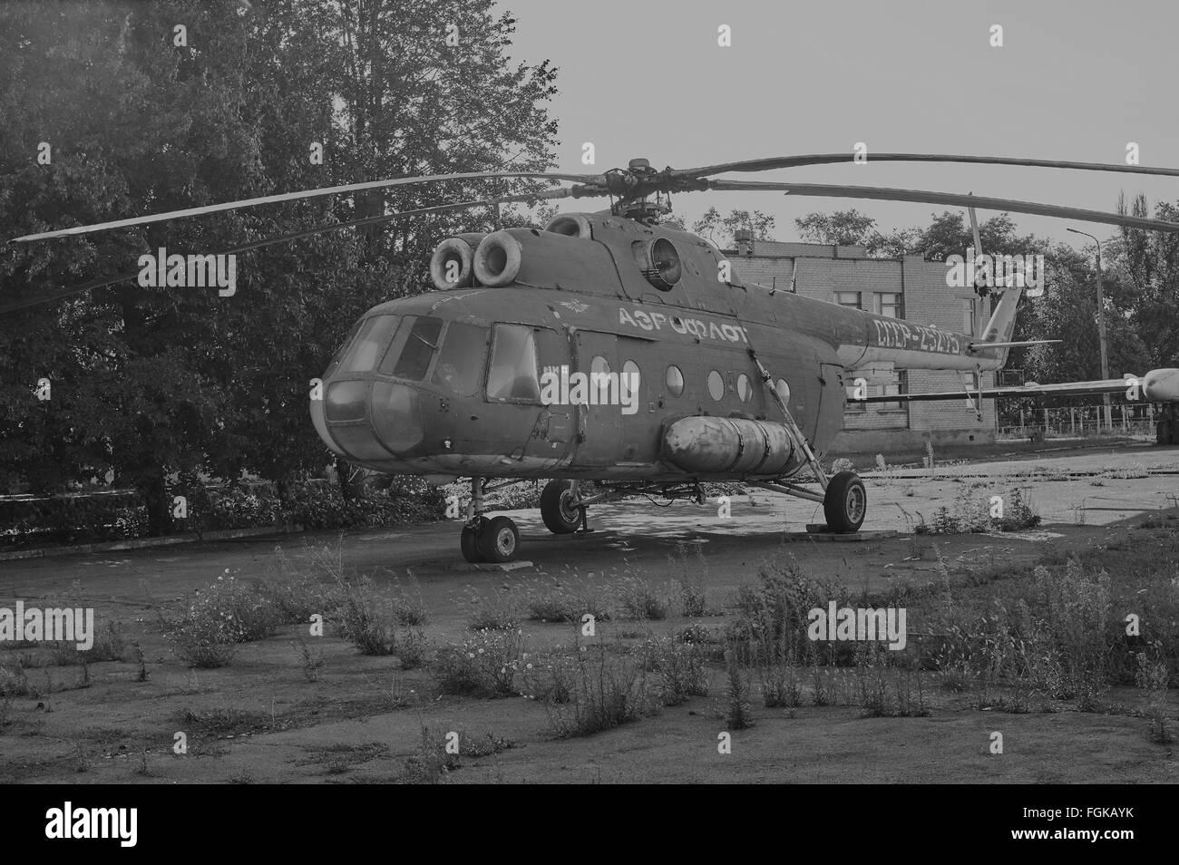KRIVOY ROG, UKRAINE - FEBRUARY 6, 2016: Old soviet helicopter MI-8 at an abandoned aerodrome. Black and white image - Stock Image