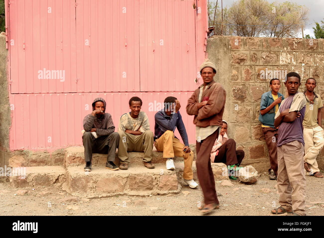 KOMBOLCHA, ETHIOPIA-MARCH 24: Devotees wait outside Bete Gebriel-St.Gabriel church compound for the religious service - Stock Image