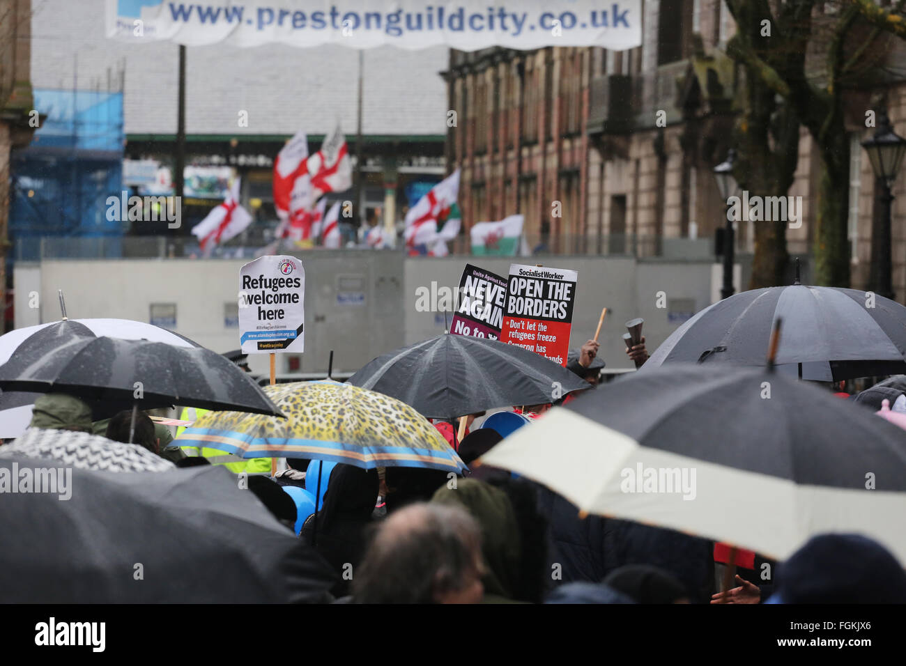 Preston, Lancashire, UK. 20th February, 2016. EDL protest in Preston, UK. Umbrellas held up alongside placards which - Stock Image