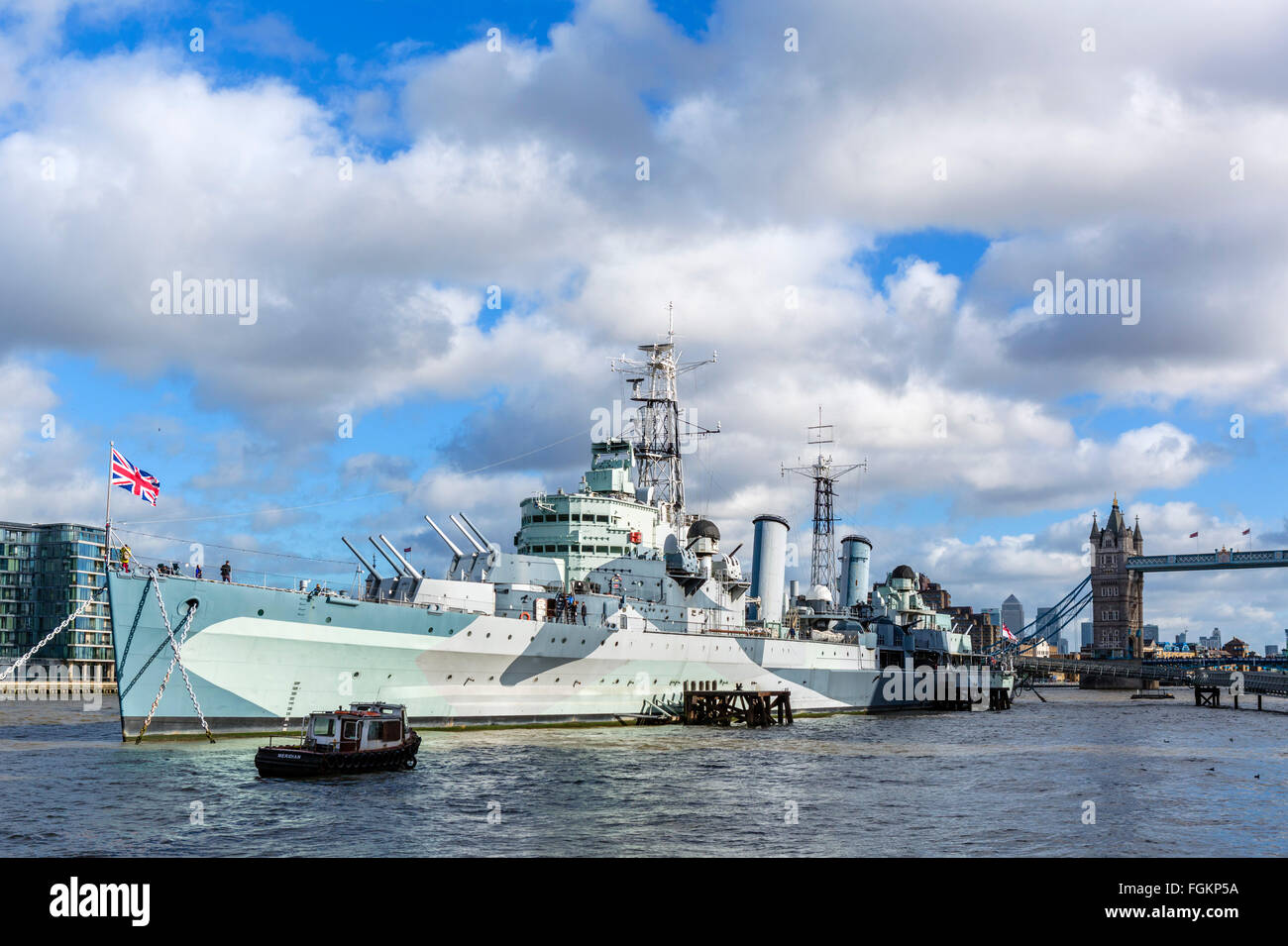 HMS Belfast, a museum ship moored on the River Thames near Tower Bridge, London, England, UK - Stock Image