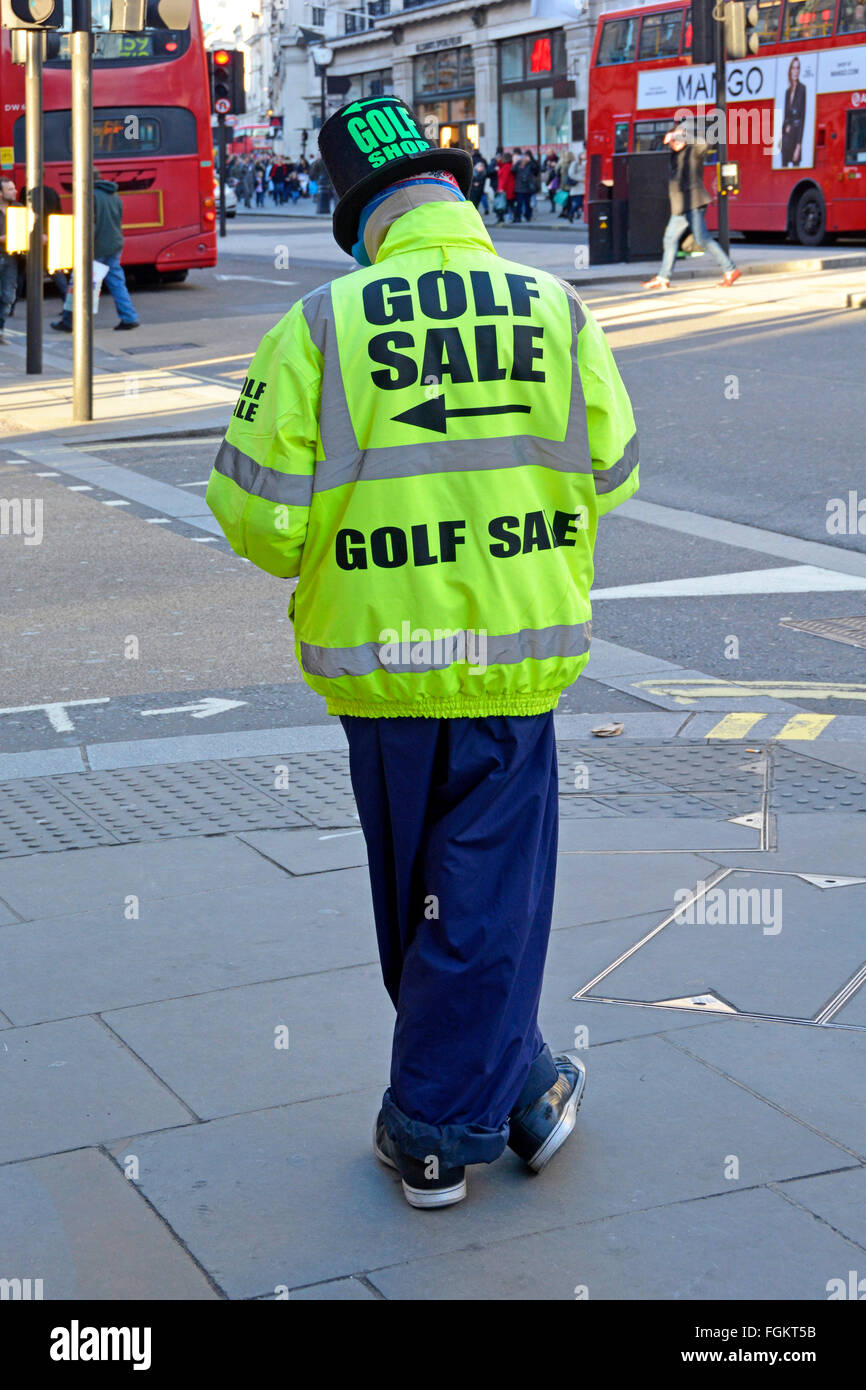 Golf Sale advertising by person standing on Regents Street London pavement wearing high vis jacket to advertise - Stock Image