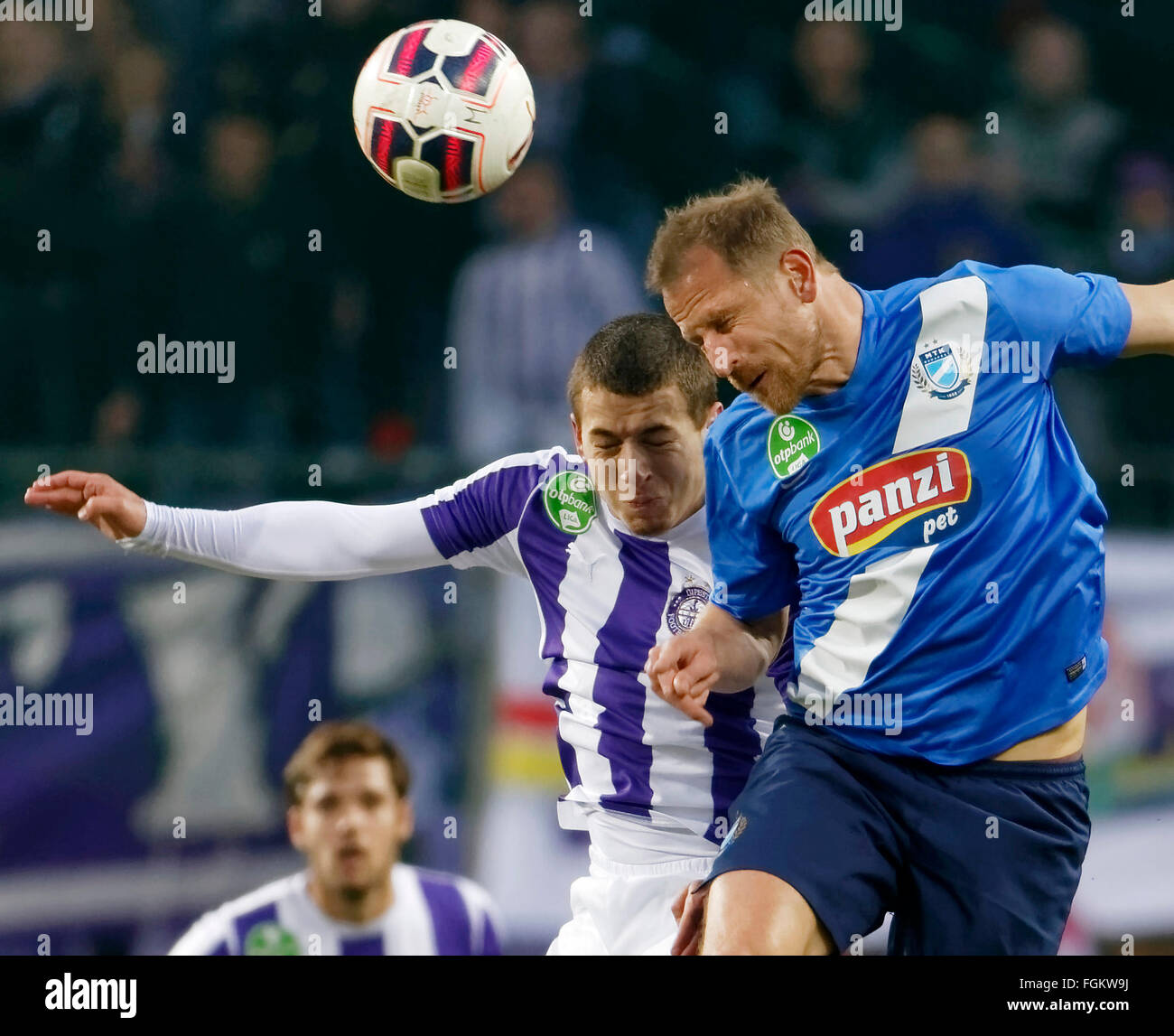 Budapest, Hungary. 20th February,  2016. Air battle between Kylian Hazard of Ujpest (l) and Sandor Torghelle of - Stock Image