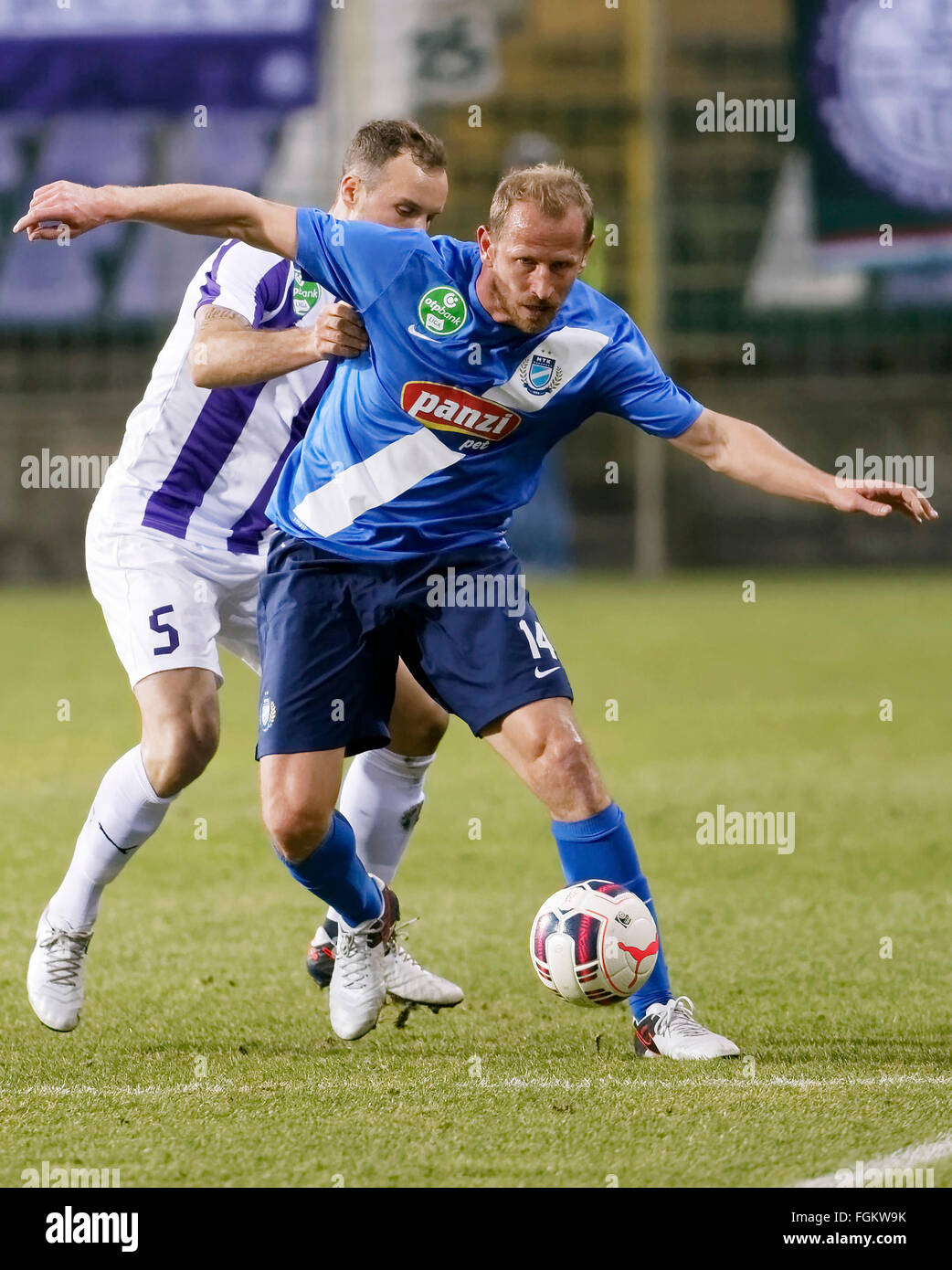 Budapest, Hungary. 20th February,  2016. From Robert Litauszki of Ujpest (l) covers the ball Sandor Torghelle of - Stock Image