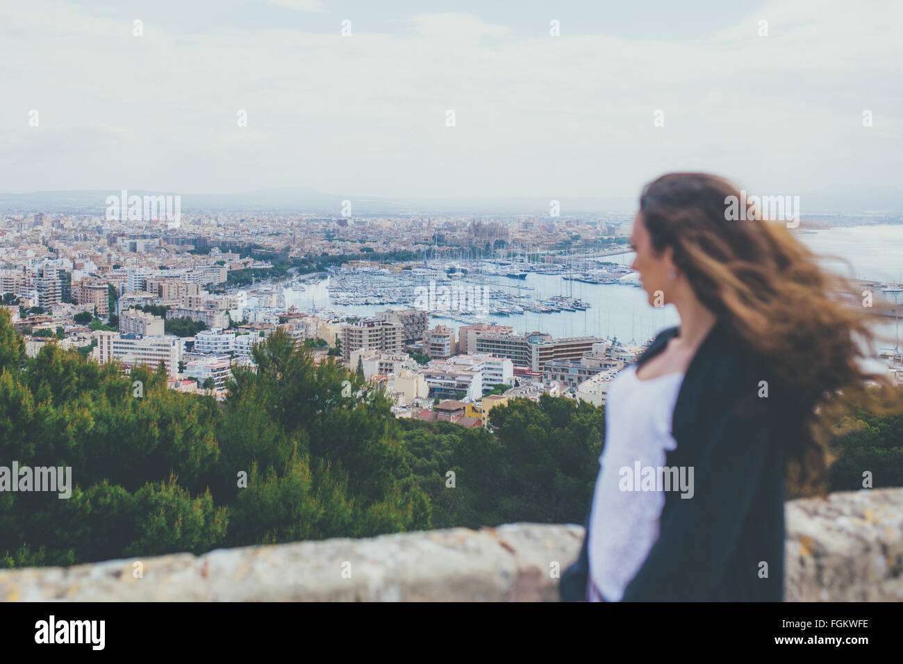 Woman looking down at the City of Palma - Stock Image