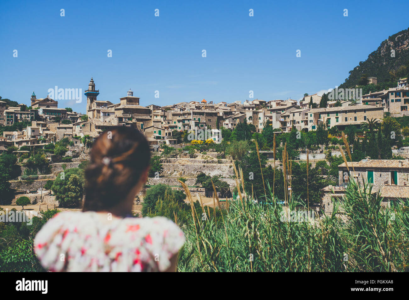 Young woman looking to Valldemosa old town - Stock Image