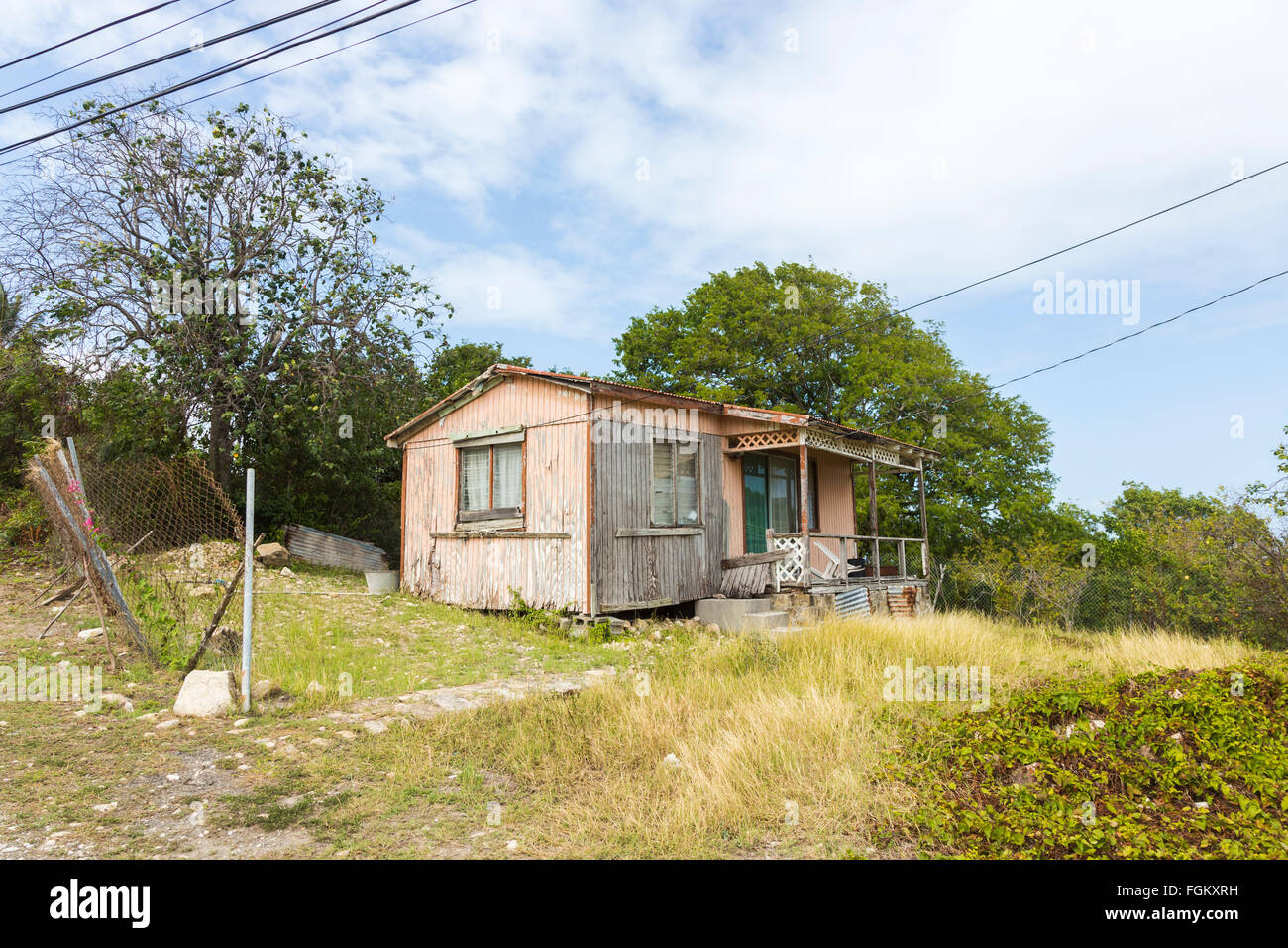 Typical run-down, ramshackle, derelict, wooden shack house near Stingray City in the east of Antigua, Antigua and - Stock Image