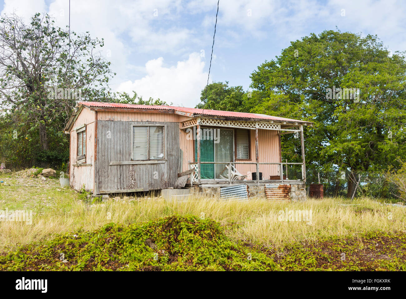 Derelict wooden house near Stingray City in the east of Antigua, Antigua and Barbuda, West Indies - Stock Image