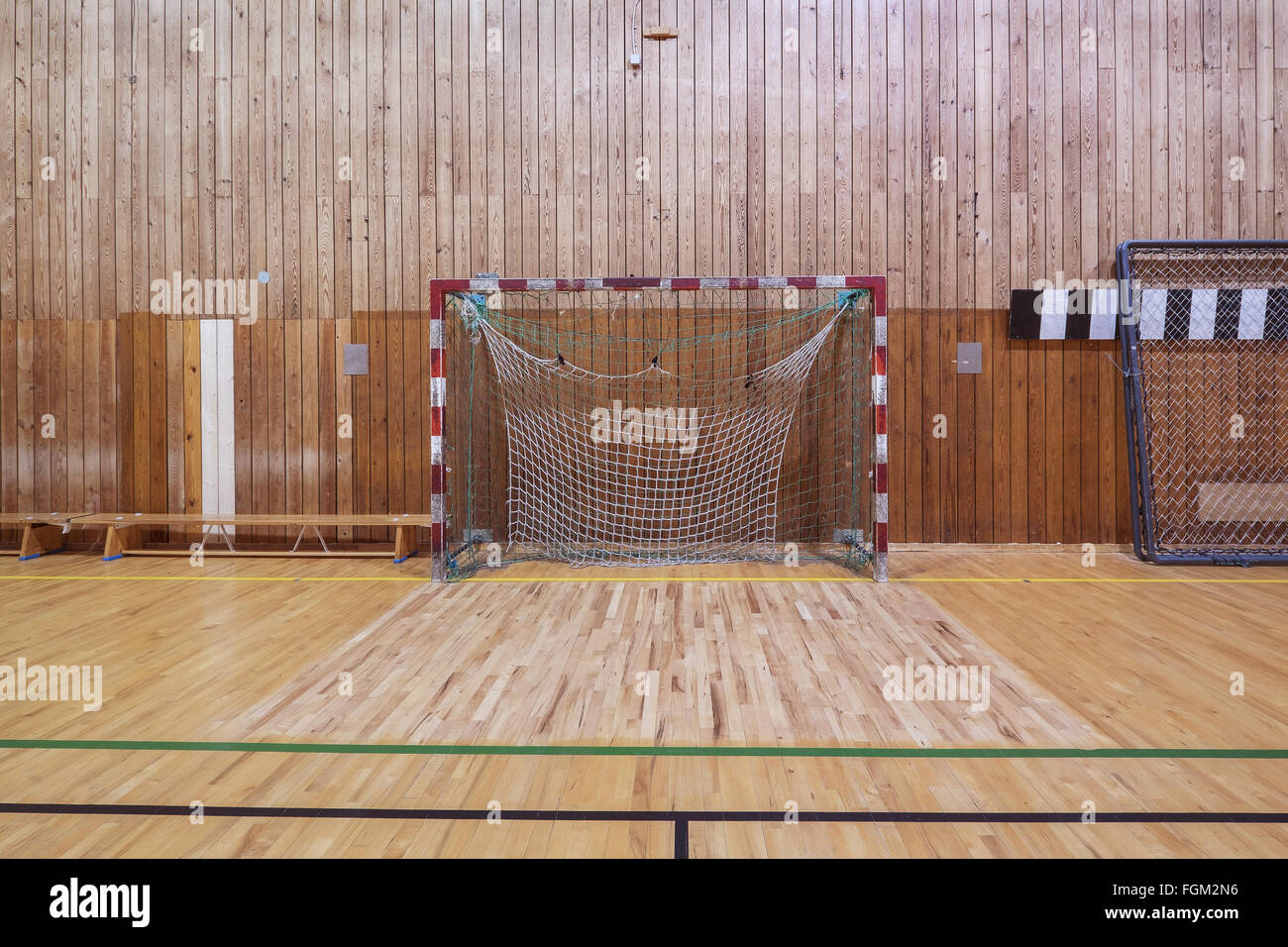 Old and worn indoor soccer gymhall - Stock Image
