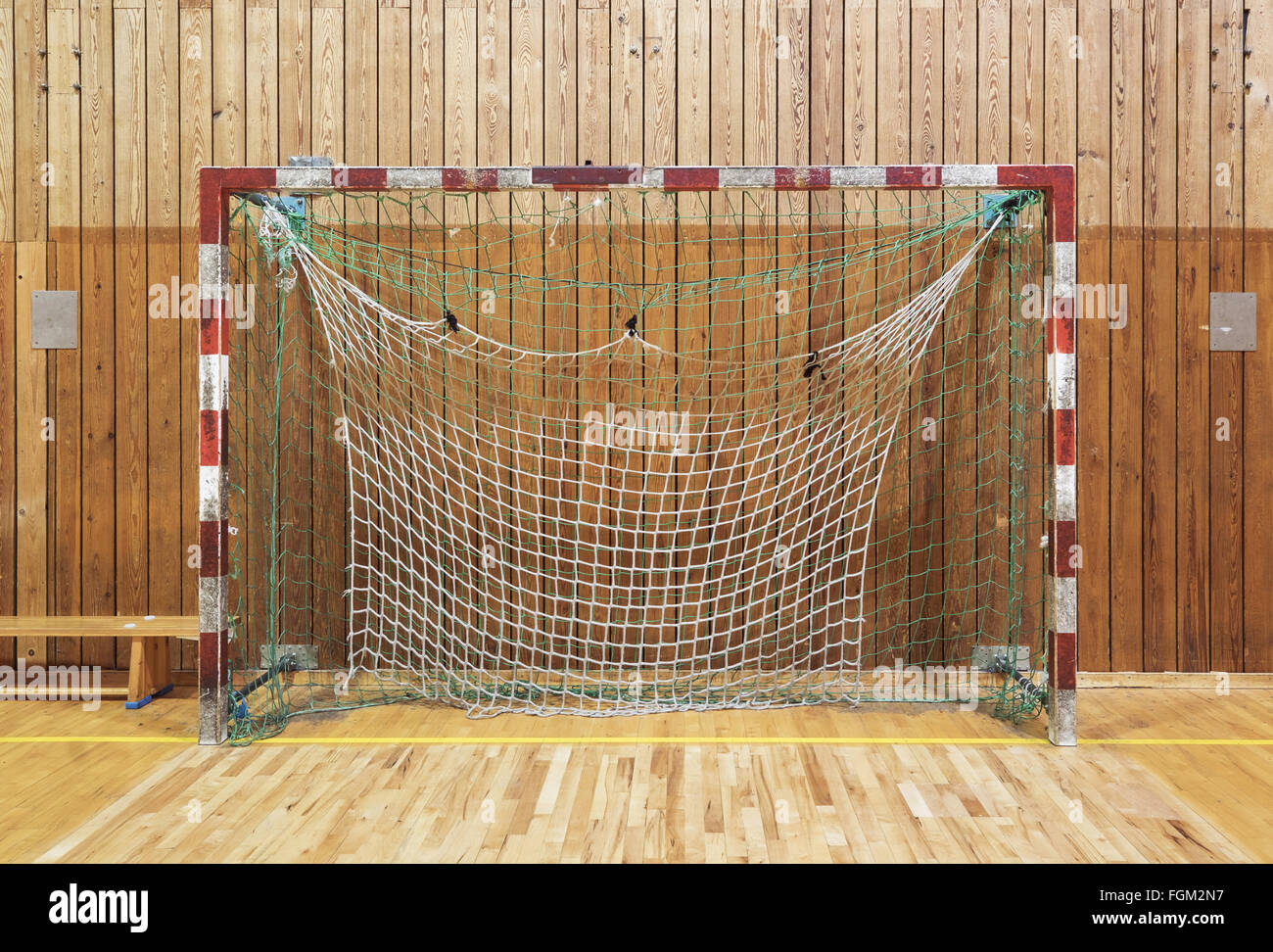 Old and worn soccer goalpost in old gymhall - Stock Image