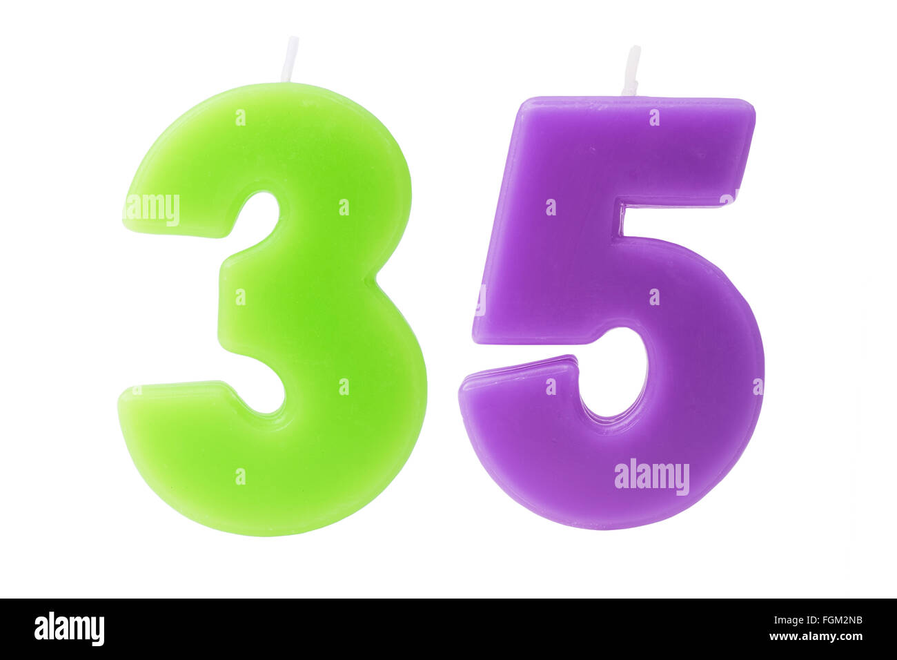 Colorful birthday candles in the form of the number 35 on white background - Stock Image