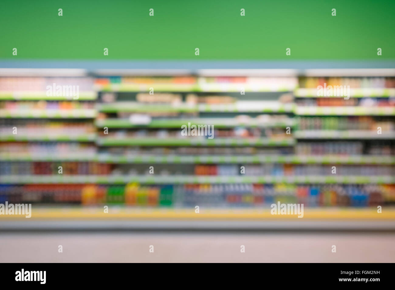 Defocused and blurry image of supermarket display shelves - Stock Image