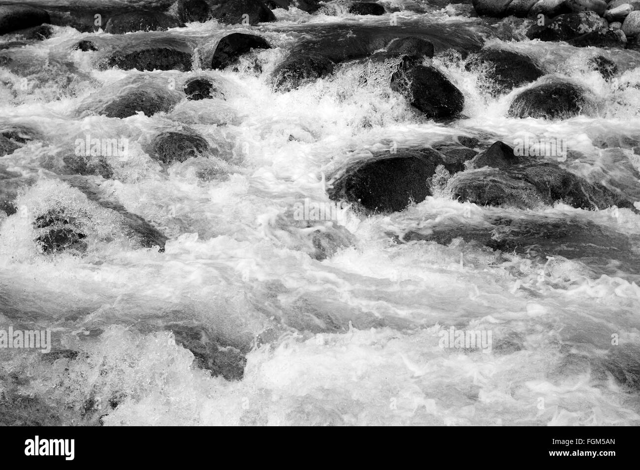 The rushing water of the river flowing down from the high mountains of Hatcher Pass in Alaska - Stock Image