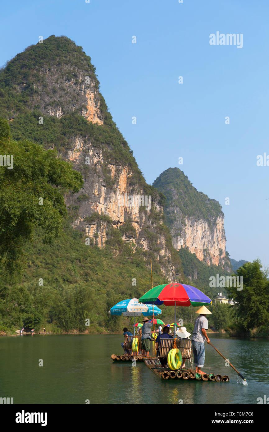 People taking bamboo raft along Yulong River, Yangshuo, Guangxi, China Stock Photo