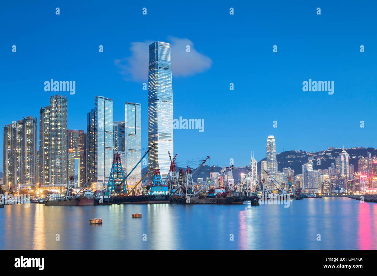 International Commerce Centre (ICC) and Yau Ma Tei Typhoon Shelter at dusk, West Kowloon, Hong Kong, China - Stock Image