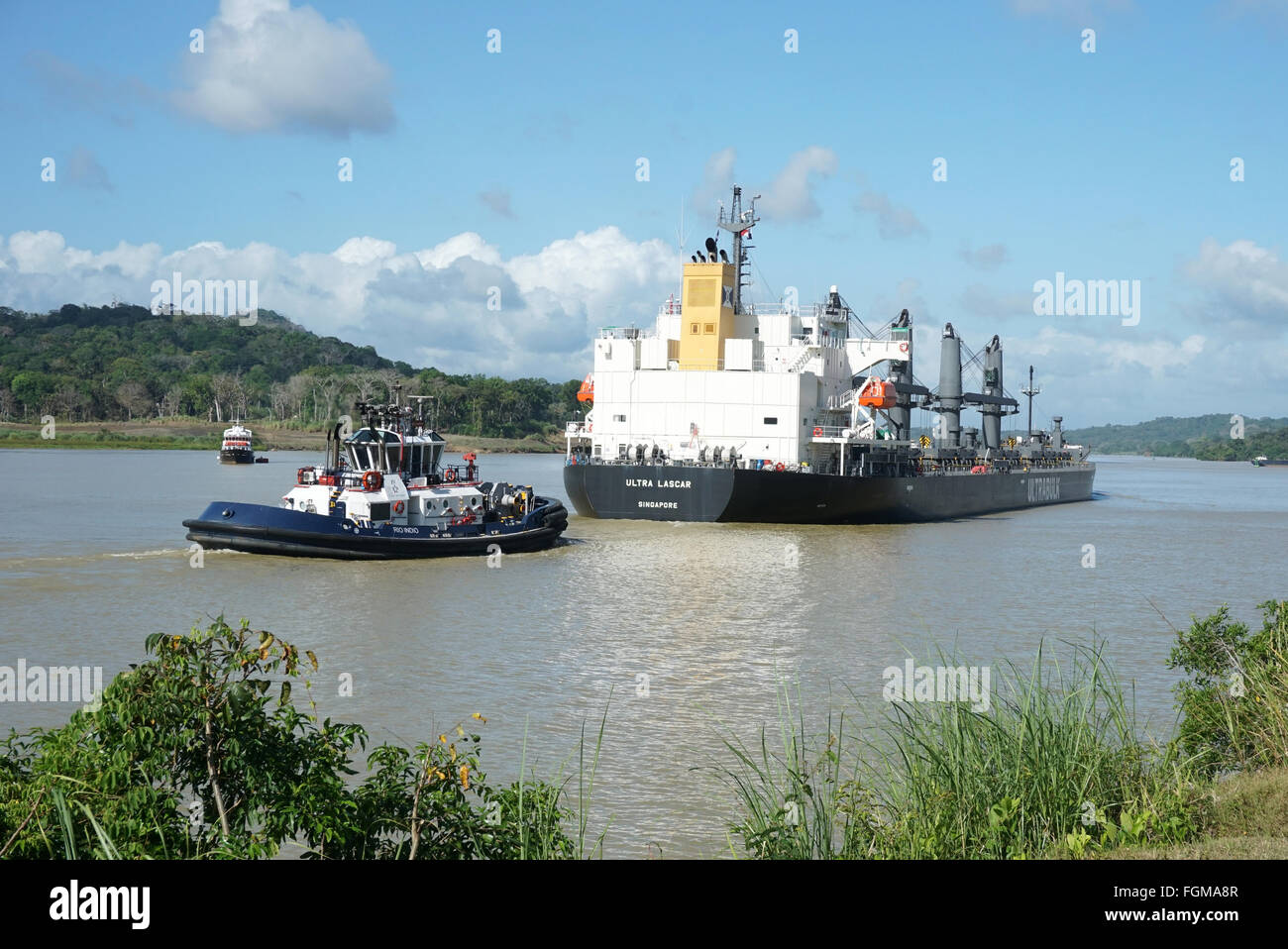 Pilot ship escorting bulk carrier at the panama canal near gamboa - Stock Image