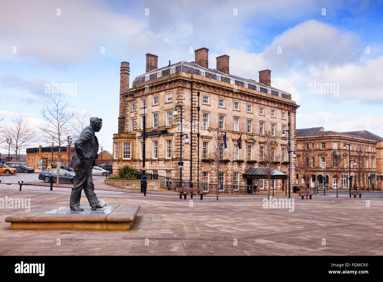 George Square, Huddersfield, in winter, with the George Hotel and statue of Harold Wilson, Huddersfield, England, - Stock Image