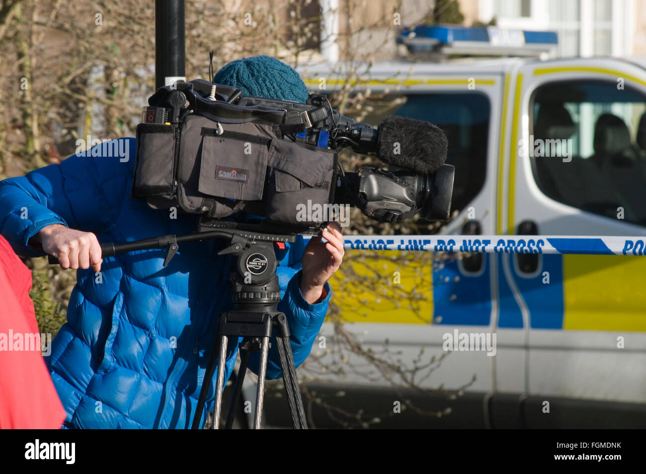 tv news crew camera man men cameraman cameramen gathering local national television broadcast broadcasters worthy - Stock Image