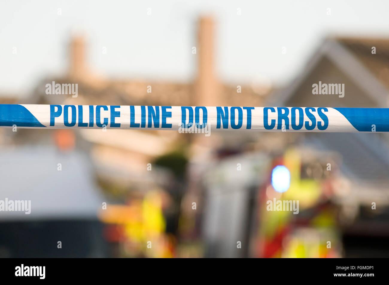 police line do not cross tape crime scene scenes investigation investigations criminal activity accident cordon Stock Photo