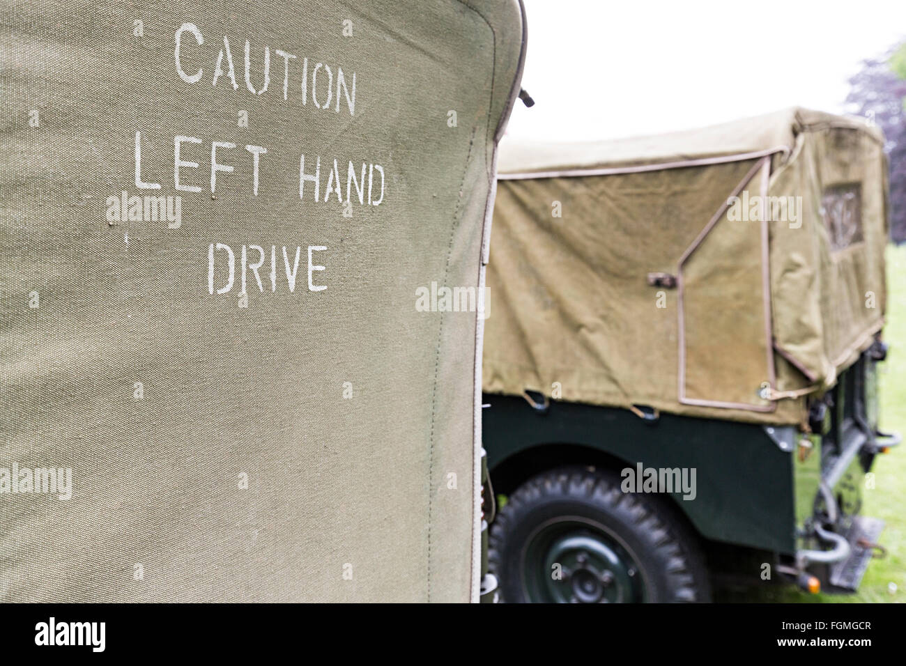 Caution Left Hand Drive notice on back of US Military jeep on display in UK - Stock Image