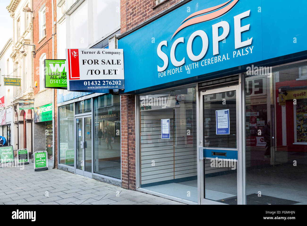 Closed down charity shop Scope in Hereford, England, UK - Stock Image
