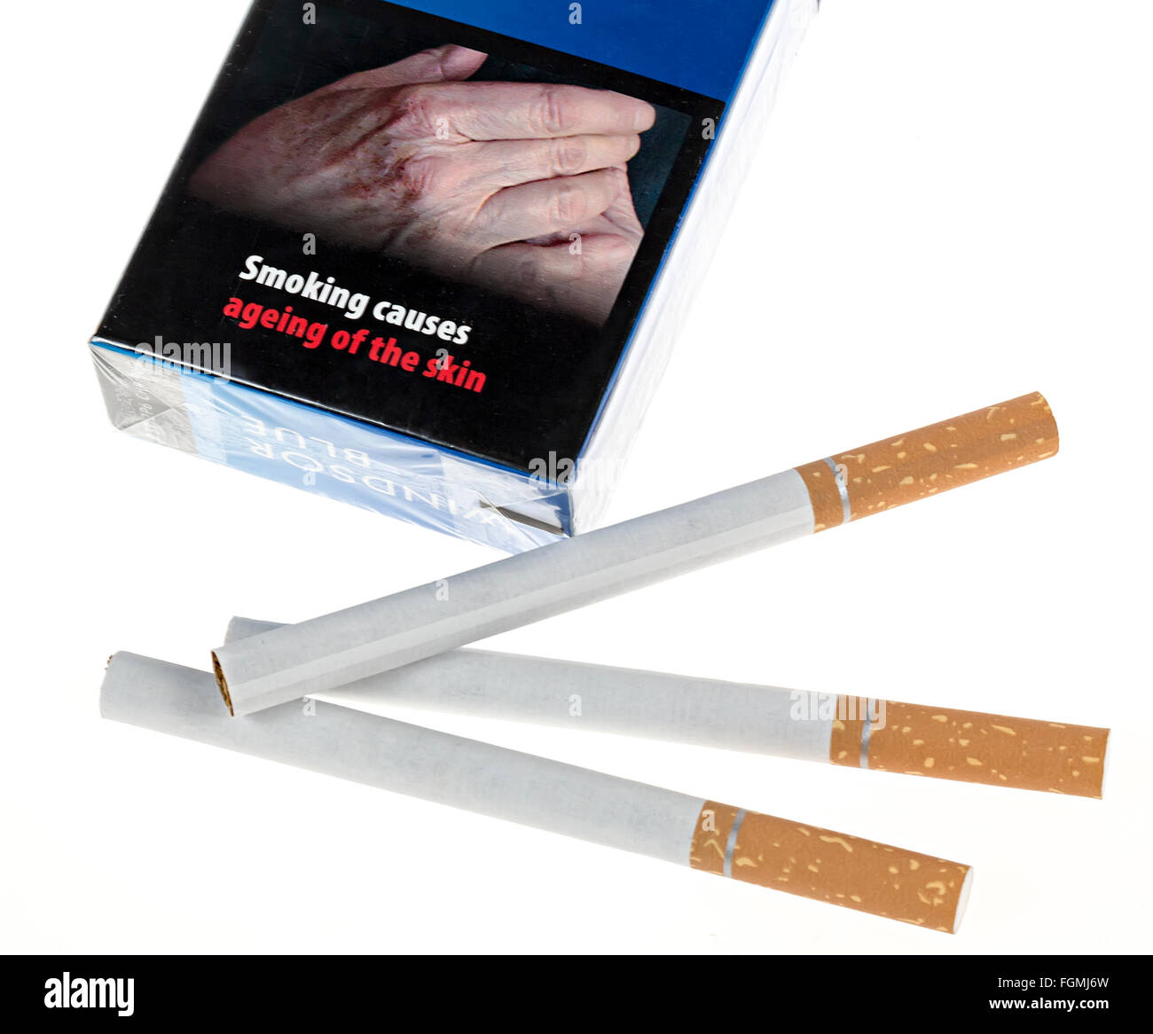 Cigarettes with packet and warning that smoking causes ageing of the skin, UK - Stock Image