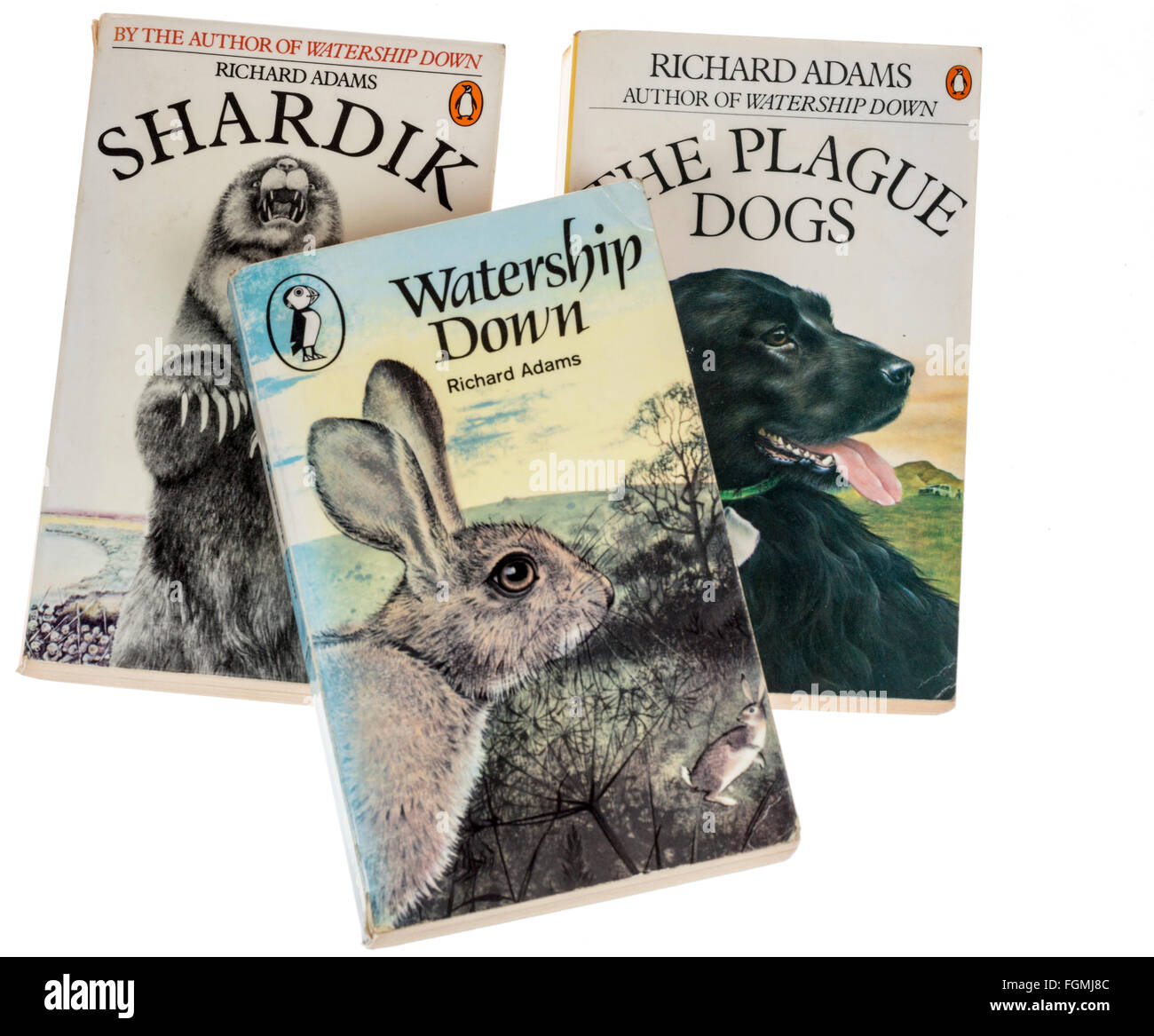 Books by Richard Adams published in paperback by Puffin, Shardik, Watership Down and The Plague Dogs - Stock Image