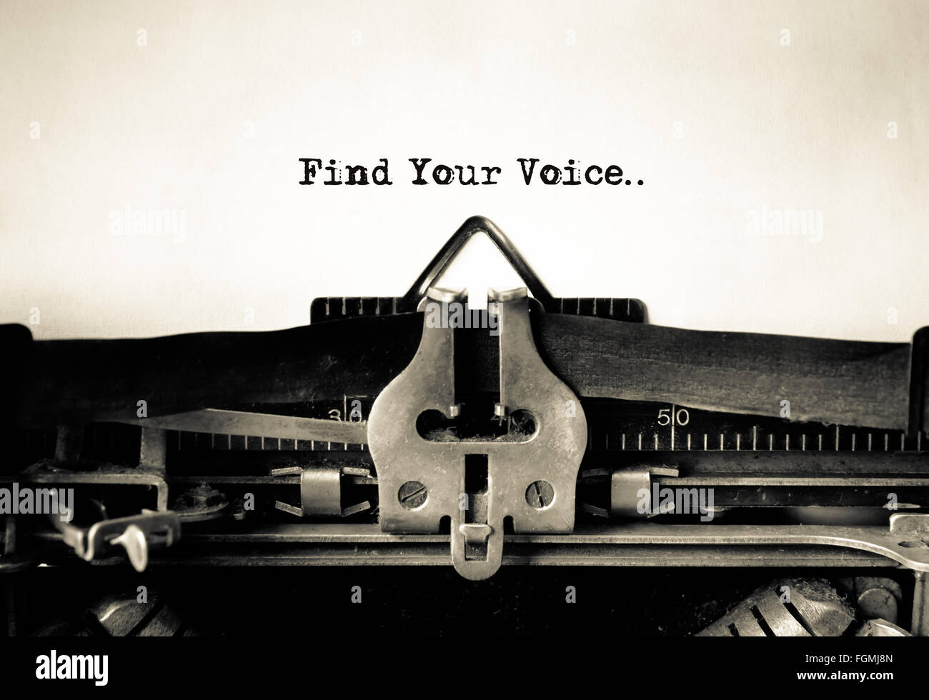 Find Your Voice message typed on vintage typewriter - Stock Image