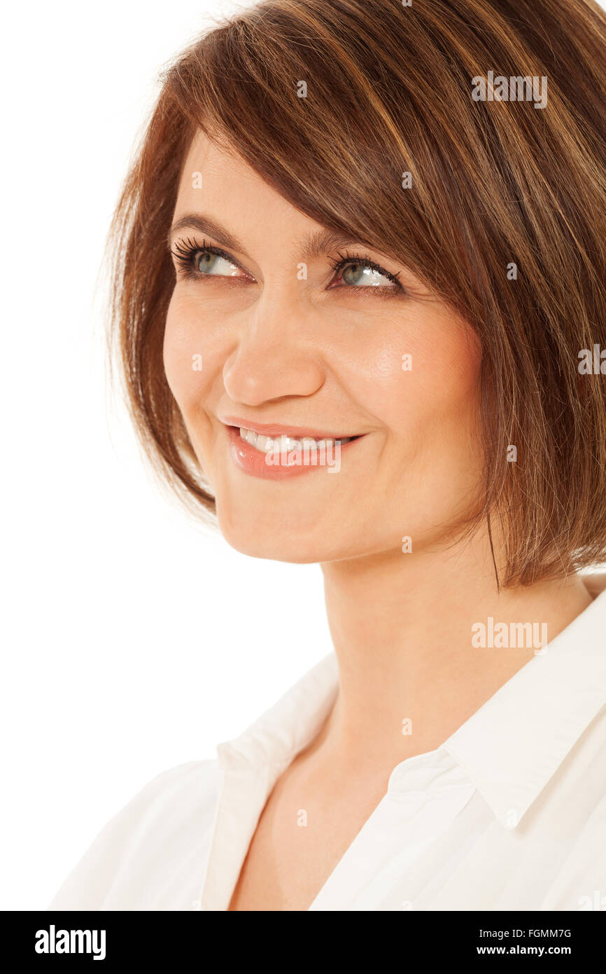 Close-up of coquettish adult woman looking up - Stock Image