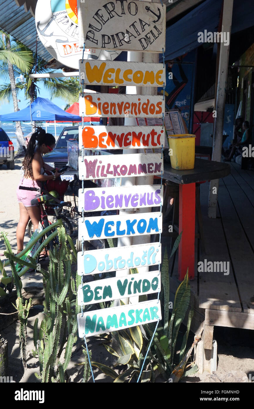 Welcome in several languages Puerto Viejo Costa Rica Stock Photo