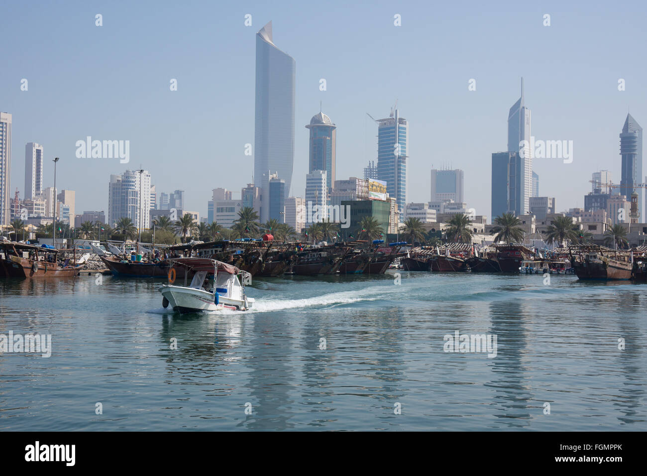 Small boat leaving a harbor in Kuwait city - Stock Image