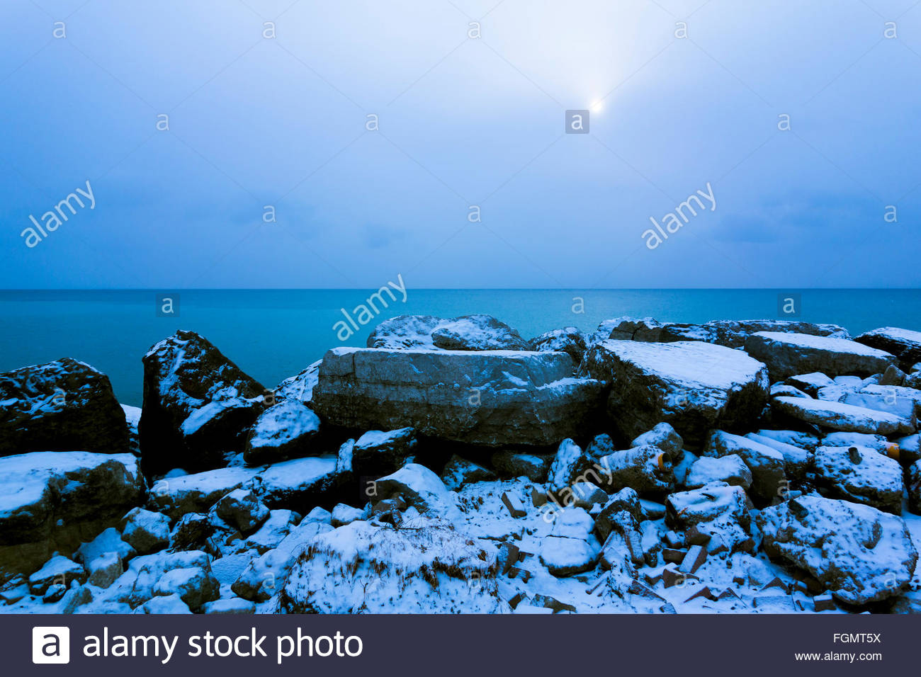 Cold rocky shore of Lake Ontario in winter near Toronto Ontario Canada The Land God gave to Cain bleak desolate - Stock Image