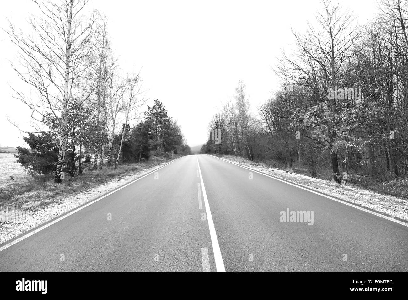 Winter landscape with a road. - Stock Image