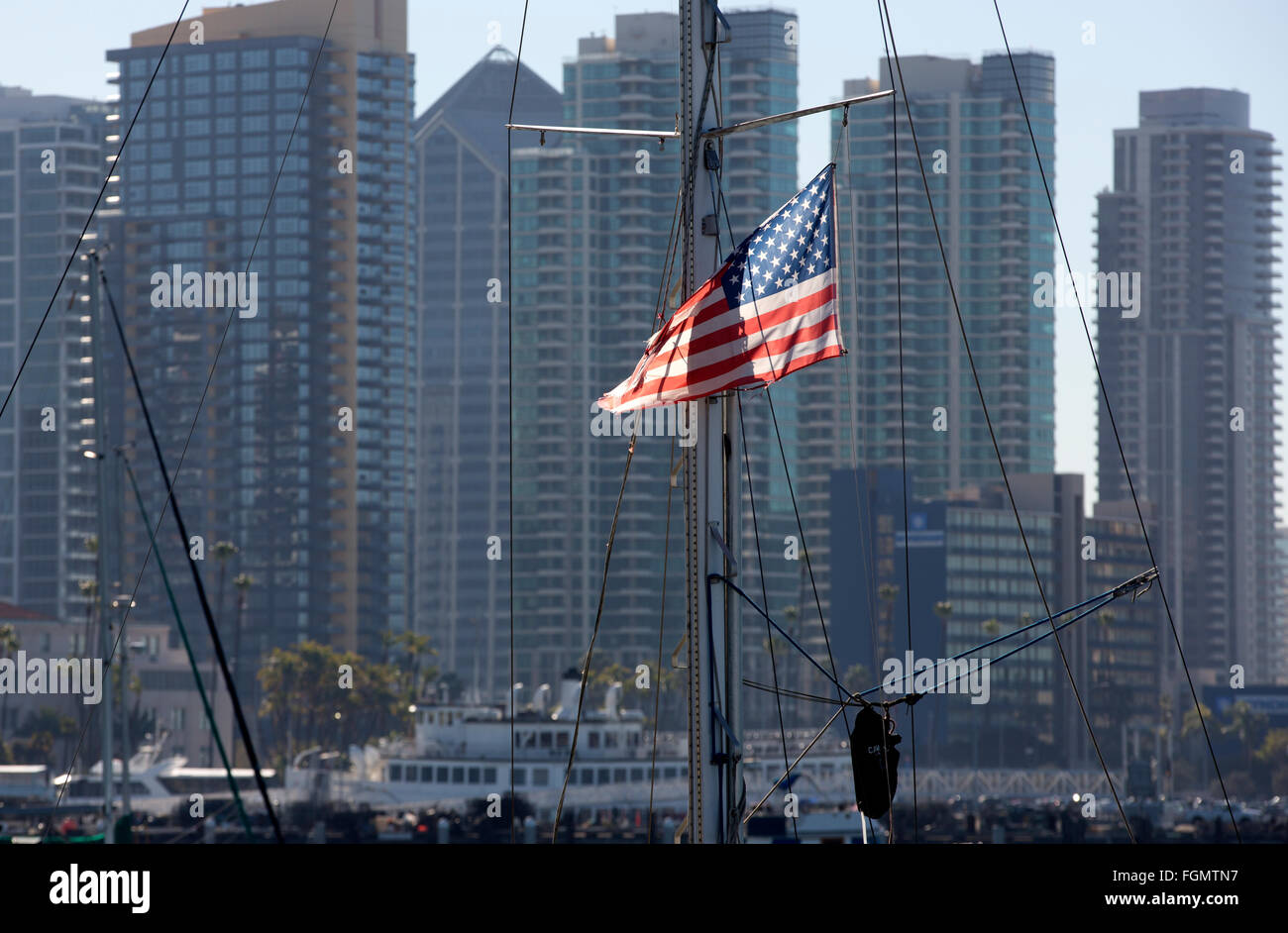 flag in sailboat rigging, San Diego skyline - Stock Image