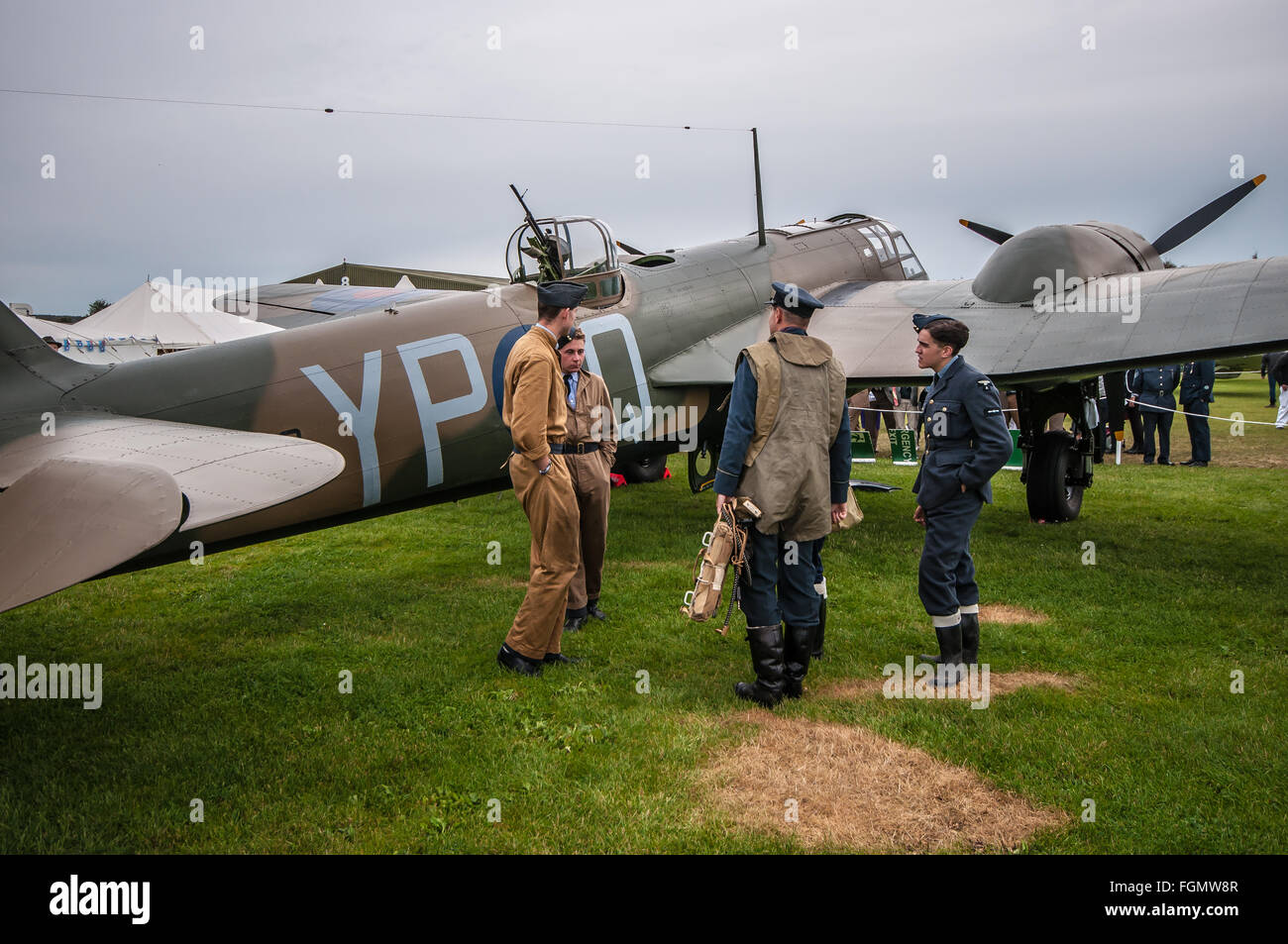 RAF re-enactors stand with a restored Bristol Blenheim MkI bomber at the Goodwood Revival 2015. Space for copy - Stock Image