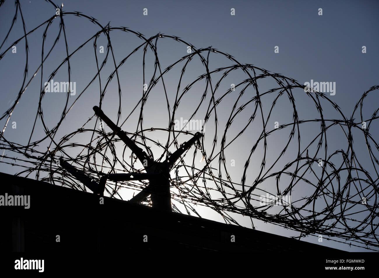 razor wire fence on the US Mexico border, Otay Mesa, California - Stock Image
