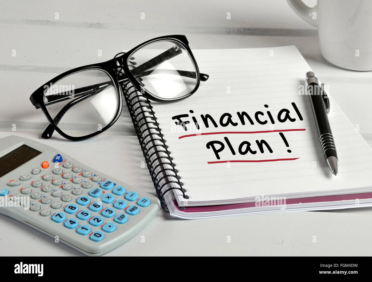 Financial Plan word on notebook page Stock Photo
