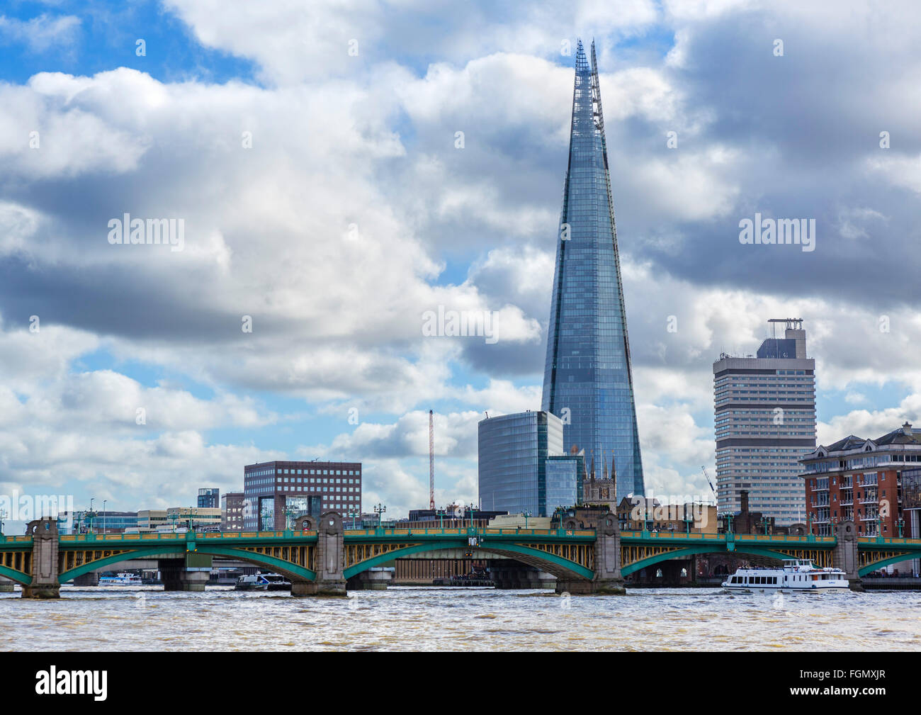 View over River Thames to Southwark Bridge with The Shard behind, Southwark, London, England, UK - Stock Image