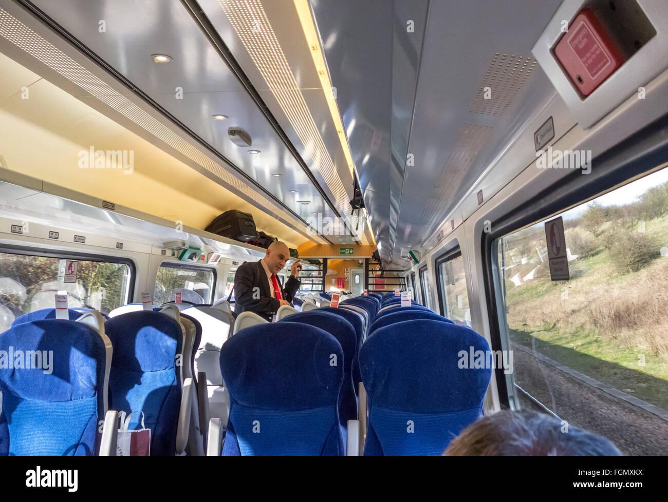 Ticket inspector on Virgin Trains East Coast line between London and Leeds, UK - Stock Image