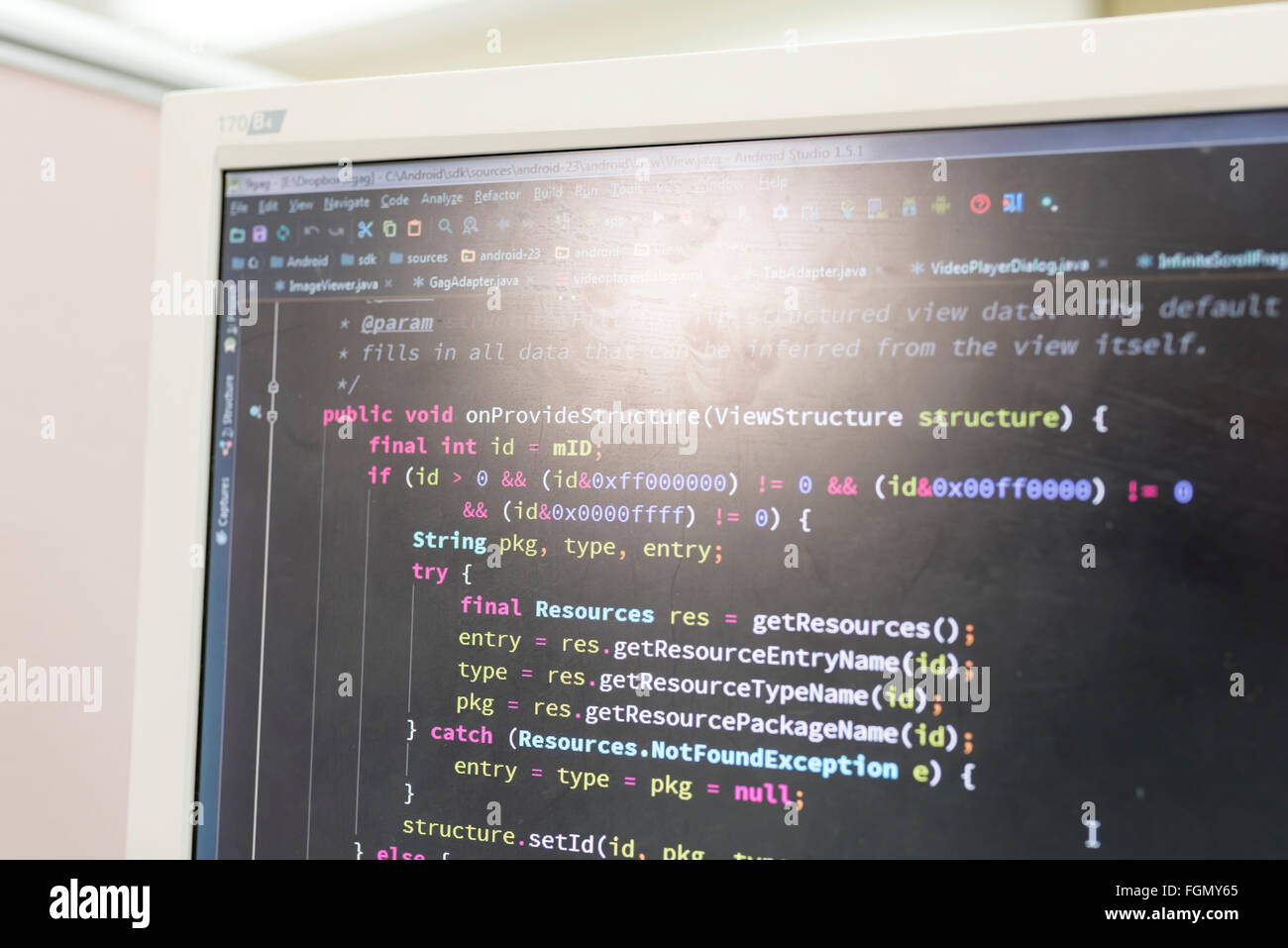 Coding on screen with colorful code - Stock Image